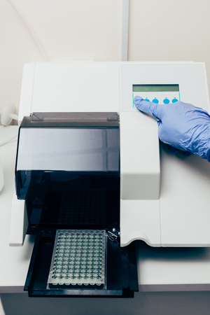 cropped image of scientist using pcr cycler in biotechnology laboratory Stock Photo
