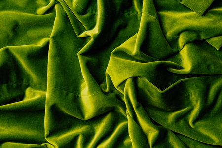 top view of green velvet textile as background