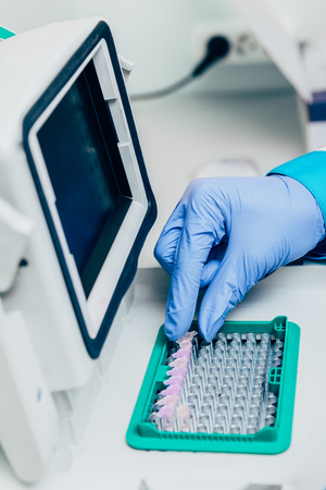 cropped image of scientist taking flask in biotechnology laboratory Stock Photo