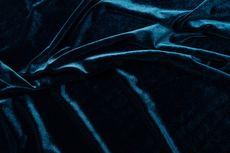 top view of dark turquoise velvet textile as background