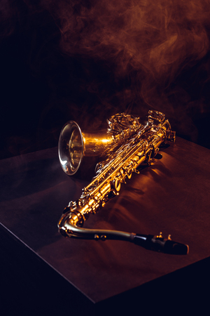 professional shiny saxophone in smoke and backlit on black 스톡 콘텐츠 - 106421468