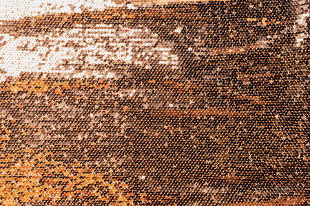 elevated view of golden textile with shiny sequins as background