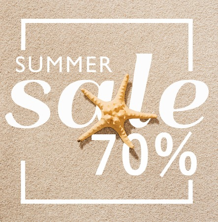 top view of dry starfish lying on sandy beach with summer sale discount Stock Photo