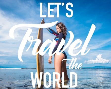 pretty woman in wetsuit with surfboard posing in ocean at Nusa dua Beach, Bali, Indonesia. Inspiration - Lets Travel the World