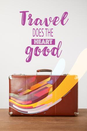 Valise vintage en cuir marron avec lettrage - Le voyage fait du bien au cœur
