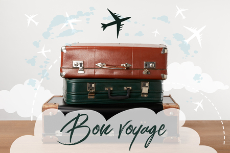 Stacked old leather travel bags with airplanes and Bon voyage (have a nice trip) inspiration 스톡 콘텐츠 - 106422183