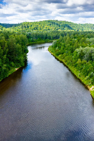 aerial view of calm river and green trees around, Riga, Latvia Reklamní fotografie