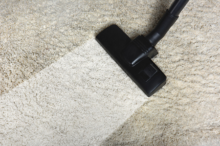 close-up view of cleaning white carpet with professional vacuum cleaner Stok Fotoğraf - 106422046