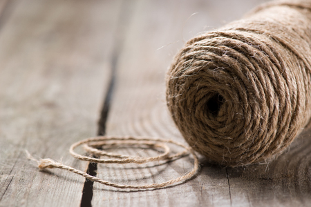 selective focus of beige string on wooden background