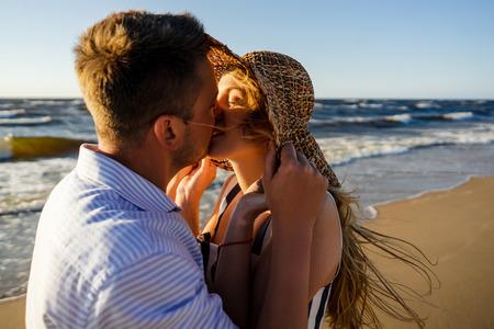couple in love kissing on seashore on summer day in Riga, Latvia