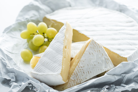close up view of camembert cheese and grape Stok Fotoğraf
