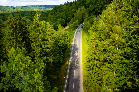 aerial view of road with green trees around, Riga, Latvia Stock fotó