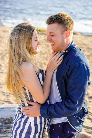 happy romantic couple in love on sandy beach with sea on background Stock Photo