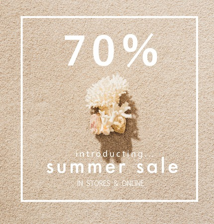 top view of coral lying on sandy beach with summer sale sign Stock Photo