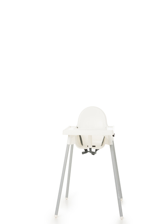 vertical shot of highchair isolated on white background Stock Photo
