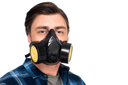portrait of young man in respirator isolated on white background Foto de archivo