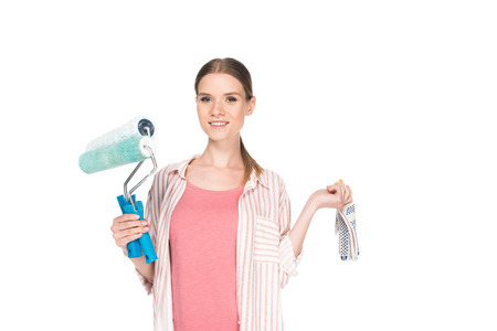 smiling young woman with paint rollers and protective gloves isolated on white background Zdjęcie Seryjne