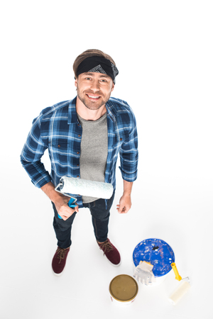 high angle view of man in headband standing with paint roller isolated on white background