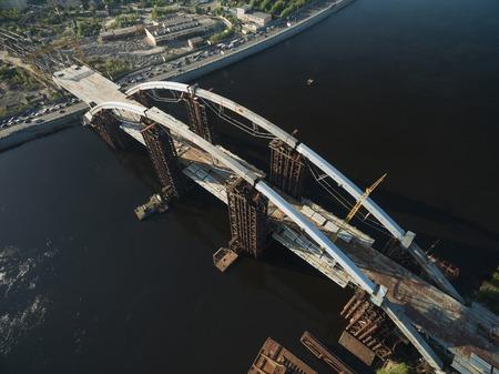 aerial view of construction site of unfinished bridge, Kyiv, Ukraine Фото со стока