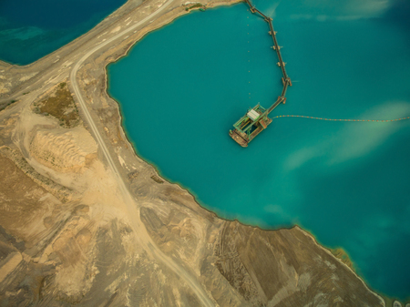 aerial view of dredge replenish sand in blue lake