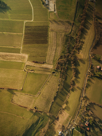 aerial view of agricultural fields on summer sunset, europe