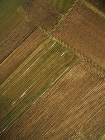 aerial view of rows of agricultural fields, europe