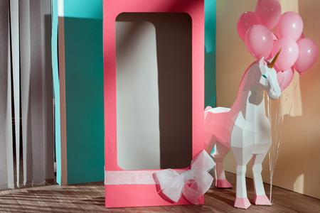 empty pink decorative box with bow and unicorn with pink balloons Reklamní fotografie