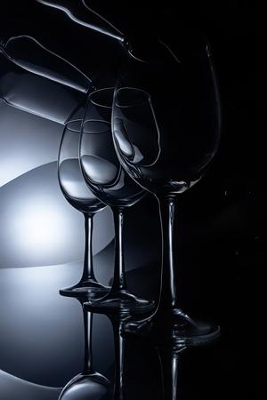 row on crystal wine glasses, dark studio shot Stock Photo - 106600821