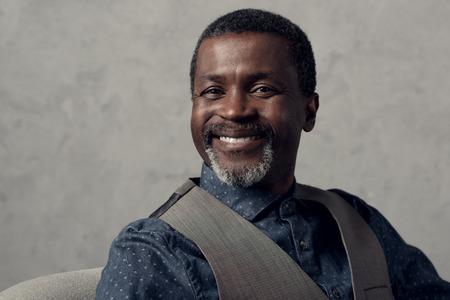 portrait of smiling mature african american man in waistcoat 写真素材