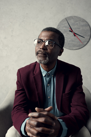 portrait of thoughtful fashionable african american man in eyeglasses