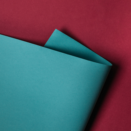 close-up view of turquoise paper sheet on maroon background