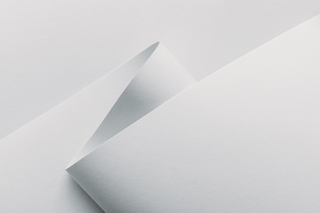 Closeup view of white rolled paper on white background Banque d'images