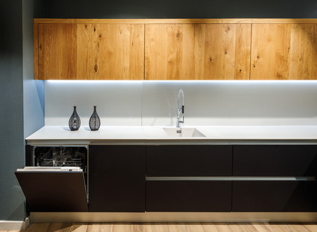 Interior of modern kitchen with white counter Standard-Bild