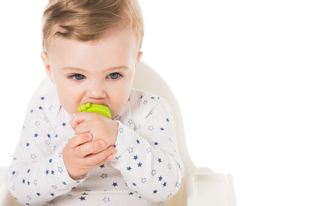 little boy with baby pacifier sitting in highchair isolated on white background Stock Photo - 106610247