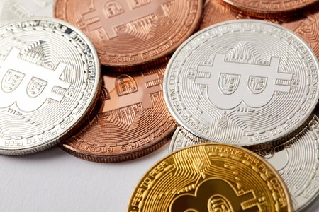 full frame shot of different bitcoins on white surface Stock Photo