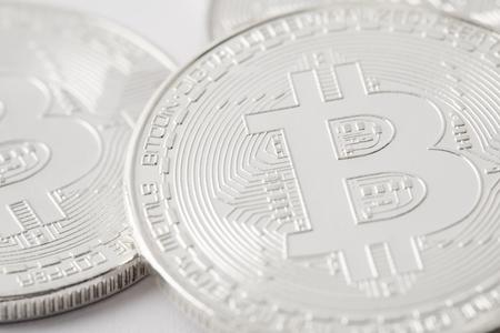 close-up shot of pile silver bitcoins Stock Photo