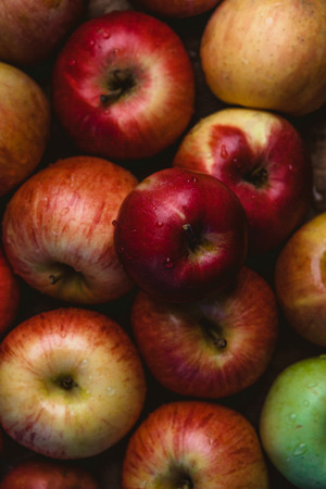 full frame image of pile of apples with water drops