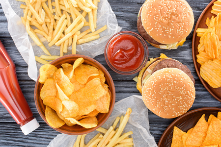 top view of assorted junk food on wooden table