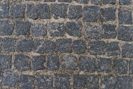 Dirty pebble stones road surface 版權商用圖片 - 106577622