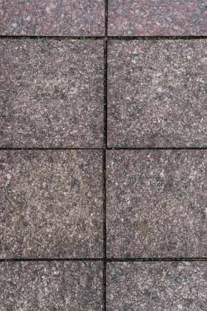 Old square stones wall surface background