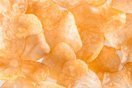 full frame view of unhealthy potato chips background on white Stock Photo
