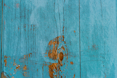 Wooden planks painted in blue background