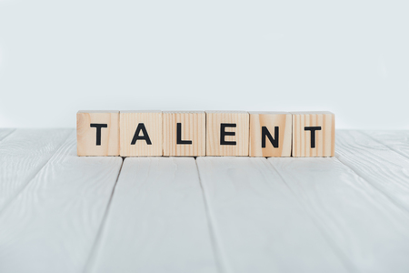 close up view of talent word made of wooden cubes on white wooden tabletop Stock Photo