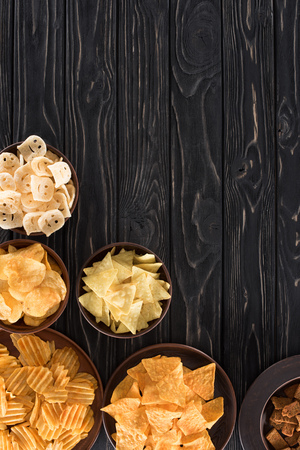 top view of various junk food and snacks on wooden table