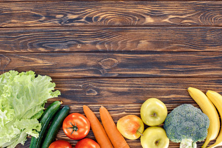 top view of fresh healthy fruits and vegetables on wooden table