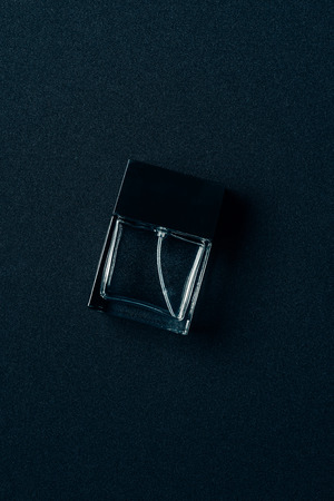 top view of bottle of aromatic perfume on black Banco de Imagens