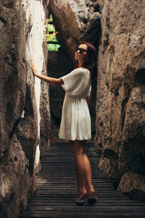 attractive woman touching cliffs at Ang Thong National Park, Ko Samui, Thailand
