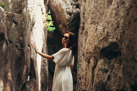 beautiful girl touching cliffs at Ang Thong National Park, Ko Samui, Thailand