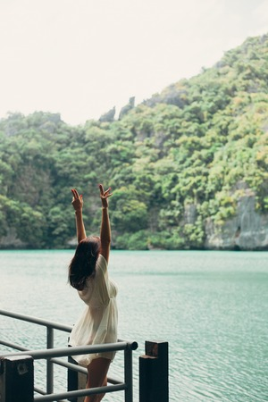 woman standing with hands up at Ang Thong National Park, Ko Samui, Thailand Zdjęcie Seryjne