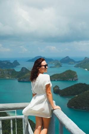 smiling traveler looking at beautiful islands in ocean at Ang Thong National Park, Ko Samui, Thailand Stock Photo